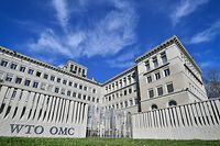 TOPSHOT - The World Trade Organization (WTO) headquarters are seen in Geneva on April 12, 2018. The World Trade Organization is set to release its latest forecasts as trade tensions between the United States and China ratchet up. / AFP PHOTO / Fabrice COFFRINI