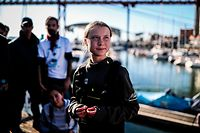 Swedish climate activist Greta Thunberg is pictured after disembarking from the catamaran La Vagabonde at the Santo Amaro docks in Lisbon, on December 3, 2019. (Photo by CARLOS COSTA / AFP)