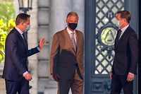 (From L) N-VA chairman Bart De Wever, King Philippe of Belgium and PS chairman Paul Magnette leave after a meeting with the King at the Royal Palace in Brussels, on July 31, 2020, regarding the formation of a new government after the federal elections of 26 May 2019. (Photo by NICOLAS MAETERLINCK / BELGA / AFP) / Belgium OUT