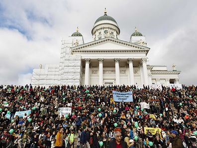 Participants demonstrate against racism and fascism in Helsinki, Finland on September 24, 2016 after a counter protester died on a farright demonstration. / AFP PHOTO / Lehtikuva / Roni Rekomaa / Finland OUT