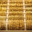 This picture taken on June 20, 2019 shows a view of gold bracelets and accessories on display at a shop in the Sudanese capital Khartoum's gold market in its downtown district. - Shops selling gold in downtown Khartoum's famous gold market have reopened in recent days after they were largely shut earlier this month as part of an overall civil disobedience campaign launched by protest leaders in the wake of a deadly crackdown on demonstrators. (Photo by Yasuyoshi CHIBA / AFP)