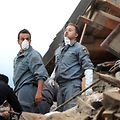 Rescuers search for victims among the rubble of a house after a strong heartquake hit Amatrice