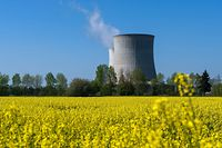 (FILES) This file photo taken on April 20, 2015 shows cooling towers of the nuclear power plant in Saint-Laurent-Nouan, central France. - The French Nuclear Safety Authority (ASN) on February 25, 2021 paved the way for the continued life of France's oldest reactors, 40 to 50 years old, enjoining French electricity company EDF to carry out work to improve their safety. (Photo by GUILLAUME SOUVANT / AFP)