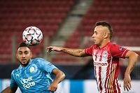 Marseille's French midfielder Dimitri Payet (L) and Olympiakos' Brazilian defender Rafinha (R) eye the ball during the UEFA Champions League Group C first-leg football match between Olympiakos and Olymnpique de Marseille (OM), at the Stadio Karaiskaki stadium, in Piraeus, on the outskirts of Athens, on October 21, 2020. (Photo by LOUISA GOULIAMAKI / AFP)