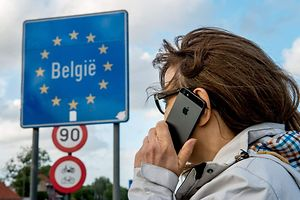 A woman uses her mobile phone in Boeschepe at the Franco-Belgian border.