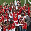 SL Benfica players jubilate after receiving the Portuguese First League Trophy after the during the Portuguese First League match against CS Maritimo held at Luz Stadium in Lisbon, 23 May 2015. JOSE SENA GOULAO/LUSA