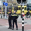Policemen are at work on March 18, 2019 in Utrecht, near a tram where a gunman opened fire killing at least three persons and wounding several in what officials said was a possible terrorist incident. (Photo by JOHN THYS / AFP)
