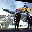 LAS VEGAS, NEVADA - JANUARY 07: Marc McCallister, VP Consumer Portfolio Management with Harley Davidson (L) talks about the the new Harley Davidson LiveWire electric motorcycle with Panasonic North America Chairman and CEO Tom Gebhardt (R) during a Panasonic press event for CES 2019 at the Mandalay Bay Convention Center on January 7, 2019 in Las Vegas, Nevada. CES, the world's largest annual consumer technology trade show, runs from January 8-11 and features about 4,500 exhibitors showing off their latest products and services to more than 180,000 attendees.   Justin Sullivan/Getty Images/AFP == FOR NEWSPAPERS, INTERNET, TELCOS & TELEVISION USE ONLY ==