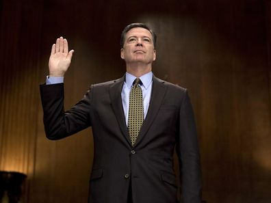(FILES) This file photo taken on May 03, 2017 shows then FBI Director James Comey being sworn in prior to testifying before the Senate Judiciary Committee on Capitol Hill in Washington, DC. James Comey, the former FBI chief whose firing by President Donald Trump has triggered uproar, has agreed to testify publicly about Russian interference in the 2016 elections, lawmakers announced May 19, 2017.  / AFP PHOTO / JIM WATSON