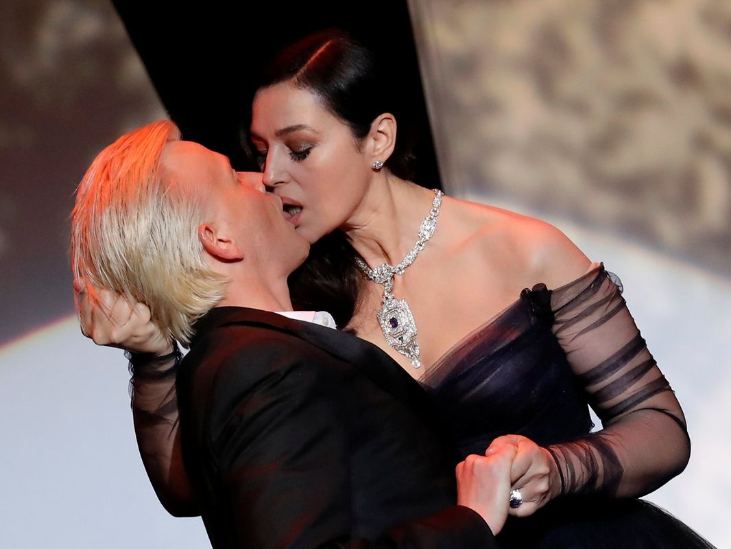 """70th Cannes Film Festival - Opening ceremony and screening of the film """"Les fantomes d'Ismael"""" (Ismael's Ghosts) out of competition  - Cannes, France. 17/05/2017. Mistress of Ceremony actress Monica Bellucci kisses actor Alex Lutz on stage.  REUTERS/Eric Gaillard     TPX IMAGES OF THE DAY"""