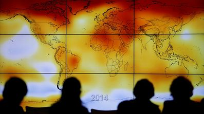 A screen showing a world map with climate anomalies during the World Climate Change Conference