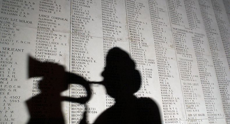YPRES, BELGIUM - NOVEMBER 7:  A bugler is silhouetted against part of a list 54,896 World War I soldiers who died between 1914 and August 15, 1917 and who have no known grave November 7, 2002 in Yrpes, Belgium. The British memorial honors soldiers who perished in the Flanders region of Belgium during the Great War. More than 8.5 million from both Allied and Central Powers died by the time the conflict ended on 11th hour of the 11th day of November, the 11th month in 1918. Each evening, a group of buglers from the local voluntary fire brigade sound the Last Post, the traditional salute to fallen warriors. The tribute draws an estimated 250,000 spectators annually.  (Photo by Paul O'Driscoll/Getty Images)