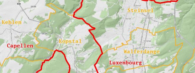 Die Kantonsgrenze (rot) verläuft so, dass die Südgemeinde nördlich der Hauptstadt liegt.