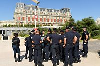 """French CRS riot police officers gather in front of Hotel du Palais of Biarritz, in Biarritz, southwestern France on August 22, 2019, where G7 delegations will be hosted, ahead of the 45th Group of Seven (G7) nations annual summit which will take place from August 24 to 26 in the French seaside resort. - A raft of unprecedented measures are set to transform the glamorous French resort of Biarritz into a security fortress as it gears up to host G7 leaders this weekend. Activists have announced a """"counter-summit"""" of thousands of people to lambast the policies of world powers, and the French authorities want at all costs to avoid the event being marred by clashes with police. (Photo by Bertrand GUAY / AFP)"""