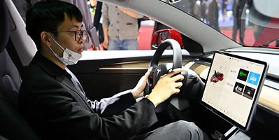 A man is seen inside of a Tesla car during the 19th Shanghai International Automobile Industry Exhibition in Shanghai on April 19, 2021.