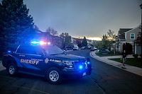 Police outside the home of one of the alleged gunmen behind the STEM School Highlands Ranch shooting in Highlands Ranch, Colorado on May 7, 2019. - A teenaged student was fatally shot and multiple others were wounded May 7 in a school shooting by fellow pupils in the US state of Colorado, across town from one of the worst gun massacres in the country's modern history. (Photo by Chet Strange / AFP)