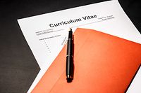 Curriculum vitae cv as concept for job search. A photograph can illustrate an article on how to properly fill out a resume when hiring.