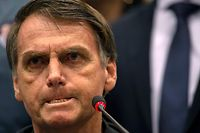 (FILES) In this file photo taken on October 11, 2018 Brazil's right-wing presidential candidate for the Social Liberal Party (PSL) Jair Bolsonaro gestures during a press conference in Rio de Janeiro, Brazil. - Jair Bolsonaro, Brazil's new president from next January 01, 2019, persuaded voters in Latin America's biggest country to elevate him to leader on extreme-right vows to restore security that eclipsed his record of racism, misogyny and homophobia. The 63-year-old former paratrooper and veteran lawmaker is openly nostalgic for the 1964-1985 military dictatorship that imposed calm in the streets. (Photo by Mauro Pimentel / AFP)