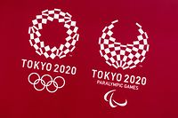 This picture shows the logos of the Tokyo 2020 Olympic and Paralympic Games in Tokyo on March 20, 2021. (Photo by Philip FONG / AFP)