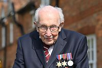 """(FILES) In this file photo taken on April 16, 2020 British World War II veteran Captain Tom Moore, 99, poses doing a lap of his garden in the village of Marston Moretaine, 50 miles north of London, on April 16, 2020. - Captain Sir Tom Moore has tested positive for Covid-19 his daughter Hannah announced on on January 31, 2021, and has been admitted to hospital where he is being treated for pneumonia. The British World War II veteran completed 100 laps of his garden in April 2020, during a fundraising challenge for healthcare staff that """"captured the heart of the nation"""", raising more than �13 million ($16.2 million, 14.9 million euros). (Photo by JUSTIN TALLIS / AFP)"""