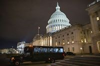 WASHINGTON, DC - JANUARY 27: Members of President Donald Trumps defense team, including high profile lawyer Alan Dershowitz (rear window), board a shuttle bus to leave the U.S. Capitol after defending the President in the Senate impeachment trial on January 27, 2020 in Washington, DC. The defense team continues its arguments on day six of the Senate impeachment trial of President Donald Trump.   Samuel Corum/Getty Images/AFP == FOR NEWSPAPERS, INTERNET, TELCOS & TELEVISION USE ONLY ==