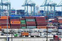 Container trucks arrive at the Port of Long Beach on August 23, 2019 in Long Beach, California. - President Donald Trump hit back at China on August 23, 2019, in their mounting trade war, raising existing and planned tariffs in retaliation for Beijing's announcement earlier in the day of new duties on American goods. (Photo by Frederic J. BROWN / AFP)