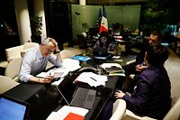 French Economy and Finance Minister Bruno Le Maire (L) speaks on the phone with his German counterpart as his advisor Juliette Oury (C), his cabinet director Emmanuel Moulin (2nd R) and French Treasury director Odile Renaud-Basso attend, during a break in a videoconference meeting of the Eurogroup of eurozone finance ministers to discuss coronavirus response on April 7, 2020 at the French Economy ministry in Paris. - EU finance ministers hope to agree a coronavirus economic rescue package for the worst-hit member states on Tuesday, but will fall short of demands from beleaguered Spain and Italy. (Photo by Thomas SAMSON / AFP)