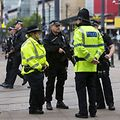 Armed police stand guard near the start of the Great Manchester Run in Manchester on May 28, 2017.  Britain police have released CCTV footage of Manchester bomber Salman Abedi on the night of the attack as thousands defied the terror threat to take part in the Great Manchester Run on Sunday. / AFP PHOTO / JON SUPER