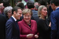 France's President Emmanuel Macron (L) talks with Germany's Chancellor Angela Merkel (2L) next to EU's High representative for foreign affairs and security policy Federica Mogherini (2R) during an European Summit aimed at discussing the Brexit deal, the long-term budget and the single market on December 13, 2018 in Brussels. - The 27 European leaders gather for a crucial European Union summit with the British Prime Minister seeking a compromise to save the Brexit deal. (Photo by EMMANUEL DUNAND / AFP)