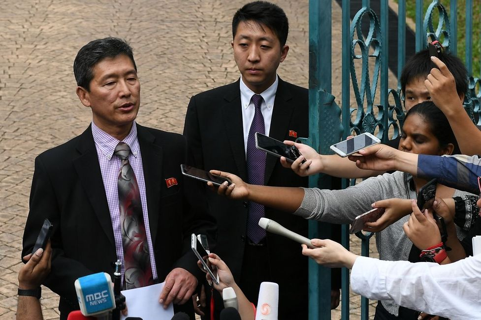 Former North Korean deputy ambassador to the United Nations Ri Tong Il (L) addresses journalists outside the North Korean embassy in Kuala Lumpur on March 2, 2017.