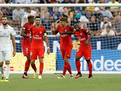 COLUMBUS, OH - JULY 27: Thomas Meunier #12 of Paris Saint-Germain F.C is congratulated by his teammates after scoring a goal during the first half of the game against Real Madrid C.F. on July 27, 2016 at Ohio Stadium in Columbus, Ohio.   Kirk Irwin/Getty Images/AFP == FOR NEWSPAPERS, INTERNET, TELCOS & TELEVISION USE ONLY ==