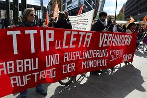 "Anti-TTIP-demonstrators hold a banner reading ""Prevent TTIP and CETA"" as they protest against the proposed US-EU free trade pact or Transatlantic Trade and Investment Partnership at Potsdamer Platz in Berlin on April 18, 2015. Nearly 600 demonstrations are planned worldwide in protest against free trade agreements, with more than 200 being held in Germany alone.      AFP PHOTO / JOHN MACDOUGALL"