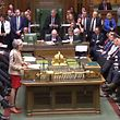 """A video grab from footage broadcast by the UK Parliament's Parliamentary Recording Unit (PRU) shows Britain's Prime Minister Theresa May (centre left) speaking in the House of Commons in London on March 29, 2019, during a debate on the Government's Withdrawal Agreement ahead of a vote on it today. - MPs are set for a momentous third vote Friday on Prime Minister Theresa May's Brexit divorce deal, which could end a months-long crisis or risk Britain crashing out of the EU in two weeks. The House of Commons has twice rejected May's withdrawal agreement, both times by large margins, but has been unable to agree any alternative -- and time is running out. (Photo by - / PRU / AFP) / RESTRICTED TO EDITORIAL USE - MANDATORY CREDIT """" AFP PHOTO / PRU """" - NO USE FOR ENTERTAINMENT, SATIRICAL, MARKETING OR ADVERTISING CAMPAIGNS - EDITORS NOTE THE IMAGE HAS BEEN DIGITALLY ALTERED AT SOURCE TO OBSCURE VISIBLE DOCUMENTS"""