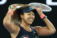 Japan's Naomi Osaka celebrates winning against Jennifer Brady of the US during their women's singles final match on day thirteen of the Australian Open tennis tournament in Melbourne on February 20, 2021. (Photo by David Gray / AFP) / -- IMAGE RESTRICTED TO EDITORIAL USE - STRICTLY NO COMMERCIAL USE --