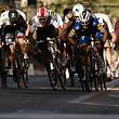 France's Julian Alaphilippe (R) sprints in the last meters to win, ahead of Belgium's Oliver Naesen (behind him L) and Poland's Michal Kwiatkowski (2ndL), the one-day classic cycling race Milan - San Remo on March 23, 2019. (Photo by Marco BERTORELLO / AFP)