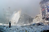 (FILES) In this file photo taken on September 11, 2001, a man stands in the rubble, and calls out asking if anyone needs help, after the collapse of the first World Trade Center Tower in New York. - Seventeen years later, more than 1,100 victims of the hijacked plane attacks on the World Trade Center have yet to be identified. But in a New York lab, a team is still avidly working to identify the remains, with technological progress on its side. Day in, day out, they repeat the same protocol dozens of times. (Photo by DOUG KANTER / AFP FILES / AFP)