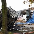 The wreckages of a truck carrying sugar beets and a school bus are seen after a collision in Bavincourt, near Arras, northern France, on November 14, 2016.  A collision between a school bus and a truck carrying sugar beets killed the bus driver and injured 3 people.  / AFP PHOTO / DENIS CHARLET