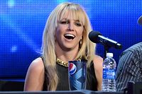 """(FILES) In this file photo former X Factor Judge Britney Spears attends Fox's """"The X Factor"""" season finale news conference at CBS Televison City on December 17, 2012 in Los Angeles, California. - A Los Angeles court denied Britney Spears' request to eject her father from a guardianship arrangement that gives him control of her affairs, US media reported on July 1, 2021. The decision comes a week after the singer made an impassioned plea to end the """"abusive"""" conservatorship during which she said she has been medicated to control her behavior, prohibited from making decisions on friendships or finances, and prevented from having a contraceptive implant removed, despite wanting more children. (Photo by Jason Merritt / GETTY IMAGES NORTH AMERICA / AFP)"""