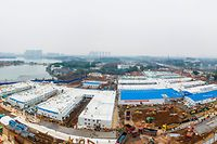 """This aerial photo taken on February 2, 2020 shows the Huoshenshan hospital, which means """"Fire God Mountain"""", after handed over to China's army in Wuhan in China's central Hubei province. - China's army on February 2 was given control of a nearly-finished field hospital that will treat patients at the epicentre of a deadly virus epidemic that has severely strained medical facilities. (Photo by STR / AFP) / China OUT"""