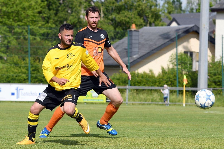 Remich-Bous - Berbourg 4-3. Olivier Grethen (en jaune) et Charel Weidert, le capitaine du Berdenia.