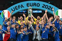 Italy's defender Giorgio Chiellini raises the European Championship trophy during the presentation after Italy won the UEFA EURO 2020 final football match between Italy and England at the Wembley Stadium in London on July 11, 2021. (Photo by Michael Regan / POOL / AFP)
