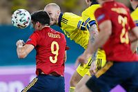 Spain's forward Gerard (L) heads the ball during the UEFA EURO 2020 Group E football match between Spain and Sweden at La Cartuja Stadium in Sevilla on June 14, 2021. (Photo by Jose Manuel Vidal / POOL / AFP)
