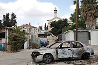 A car that was burned during the recent intra-communal violence between Palestinians and Israelis in the Israeli Arab city of Lod near Tel Aviv, is pictured on May 23, 2021. - Intra-communal violence flared in Israel during the recent unrest that spiralled into a conflict in which the Islamist group Hamas fired rockets from Gaza, and Israel launched air strikes. (Photo by GIL COHEN-MAGEN / AFP)