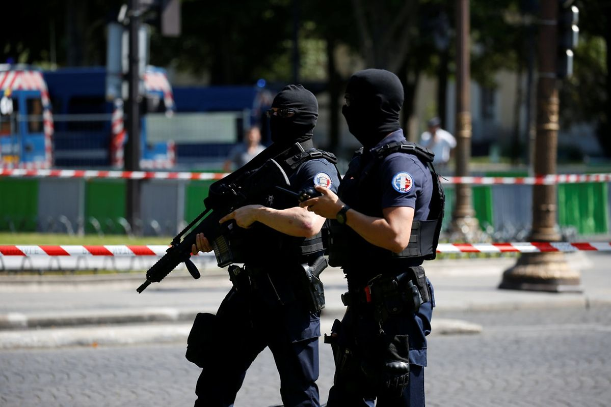 Masked and armed French policemen secure the Champs Elysees avenue after an incident in Paris, France, June 19, 2017 . REUTERS/Gonzalo Fuentes