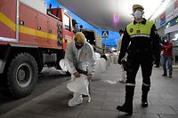 Members of the Military Emergencies Unit (UME) prepare to carry out a general disinfection at Josep Tarradellas Barcelona-El Prat airport in El Prat de Llobregat on March 19, 2020. - Spain today announced that deaths from the novel coronavirus had jumped by nearly 30 percent over the past 24 hours to 767. The number of people who have contracted the disease has meanwhile grown by around 25 percent to 17,147, according to health ministry figures, bringing Spain's tally near that of Iran, the world's third most affected country after China and Italy. (Photo by Josep LAGO / AFP)