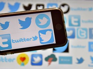 """(FILES) This file photo taken on December 28, 2016 shows logos of US online news and social networking service Twitter in Vertou, western France. Twitter said March 21, 2017 it suspended 376,890 accounts in the second half of 2016 for """"promotion of terrorism,"""" an increase of 60 percent over the prior six-month period.The latest suspensions bring the total number of blocked accounts to 636,248 from August 2015, when Twitter stepped up efforts to curb """"violent extremism,"""" the company announced as part of its latest transparency report.  / AFP PHOTO / LOIC VENANCE"""