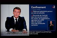French President Emmanuel Macron is seen on a TV screen in Paris on October 28, 2020, as he delivers an evening televised address to the nation, to announce new measures aimed curbing the spread of the Covid-19 pandemic, caused by the novel coronavirus. - France was preparing on October 28 for tough new restrictions to halt a flare-up in Covid-19 cases that has alarmed doctors, with a second lockdown widely mooted as hospitals battle an influx of patients. (Photo by Ludovic MARIN / AFP)