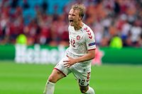 Denmark's forward Kasper Dolberg celebrates scoring their second goal during the UEFA EURO 2020 round of 16 football match between Wales and Denmark at the Johan Cruyff Arena in Amsterdam on June 26, 2021. (Photo by Olaf Kraak / POOL / AFP)