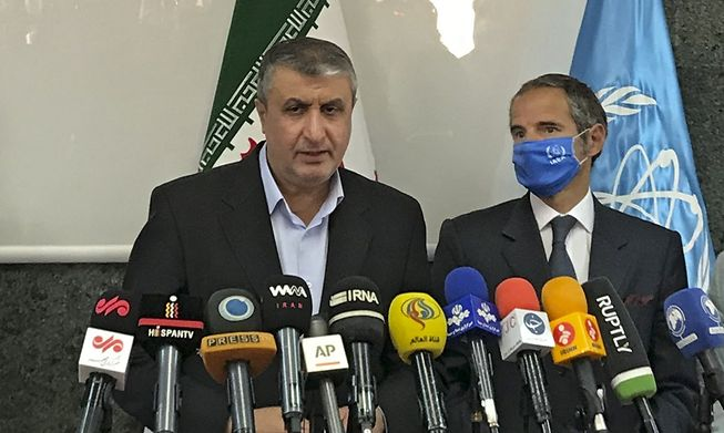 Head of Iran's nuclear agency, Mohammad Eslami (left), speaks to the media alongside Director General of the International Atomic Energy Agency, Rafael Grossi, following their meeting in Tehran on Sunday