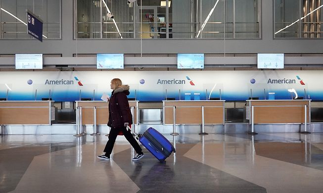 A passenger arrives for an American Airlines flight at O'Hare International Airport in February in Chicago, Illinois